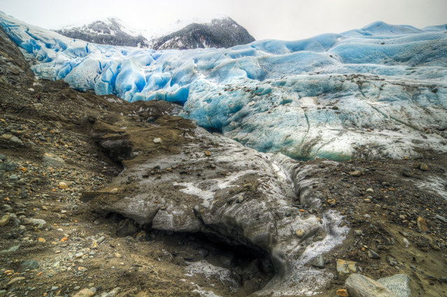 The entrance to the stunning Alaskan ice cave. (Photo by Ron Gile/Caters News)