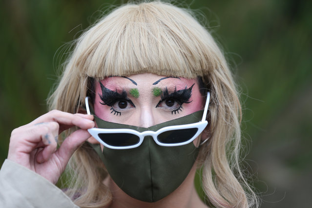 A member of an LGBT rights group looks on during a protest outside the Siglo XXI Hospital in Mexico City, Mexico, 24 June 2020. LGBT activists denounced a series of inconsistencies in the investigations into the recent death of transgender doctor Maria Elizabeth Montano. The body of Montano, a Mexican Institute of Social Security (IMSS) worker who went missing on 08 June 2020, was found on 19 June on a road near the town of Tres Marias, in the neighboring state of Morelos. (Photo by Saschenka Gutierrez/EPA/EFE)