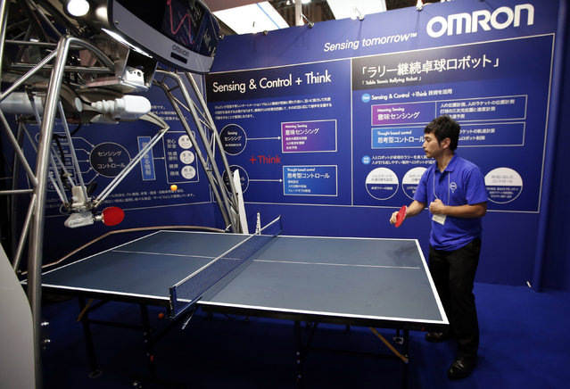 Japan's Omron Corp. demonstrates a table tennis playing robot at CEATEC (Combined Exhibition of Advanced Technologies) JAPAN 2014 in Chiba, east of Tokyo, October 7, 2014. (Photo by Issei Kato/Reuters)