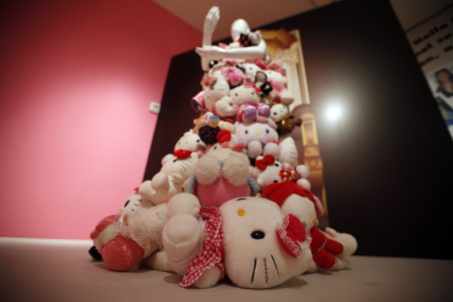 """A dress made by GK Reid and with Hello Kitties is displayed at the """"Hello! Exploring the Supercute World of Hello Kitty"""" museum exhibit in honor of Hello Kitty's 40th anniversary, at the Japanese American National Museum in Los Angeles, California October 10, 2014. (Photo by Lucy Nicholson/Reuters)"""