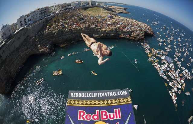 David Colturi of the USA dives from the 27 metre platform during the fifth stop of the Red Bull Cliff Diving World Series in Polignano a Mare, Italy on August 28 2016. (Photo by Dean Treml/ANSA/Red Bull Press Office)
