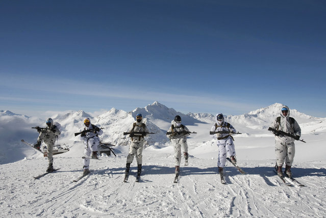 Russian army soldiers in winter camouflage go through training exercises at an altitude of 3,500 meters on the slopes of Mount Elbrus in Russia's Caucasus January 18, 2013. (Photo by Kazbek Basayev/Reuters)