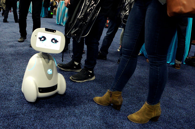 A Buddy robot by Blue Frog roams the floor during the opening event at CES in Las Vegas, Nevada, U.S. January 8, 2018. (Photo by Rick Wilking/Reuters)