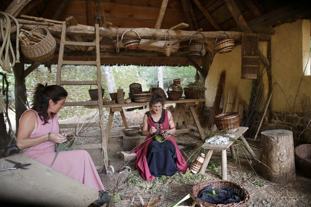Women work at the construction site of the Chateau de Guedelon near Treigny in the Burgundy region of France, September 13, 2016. (Photo by Jacky Naegelen/Reuters)