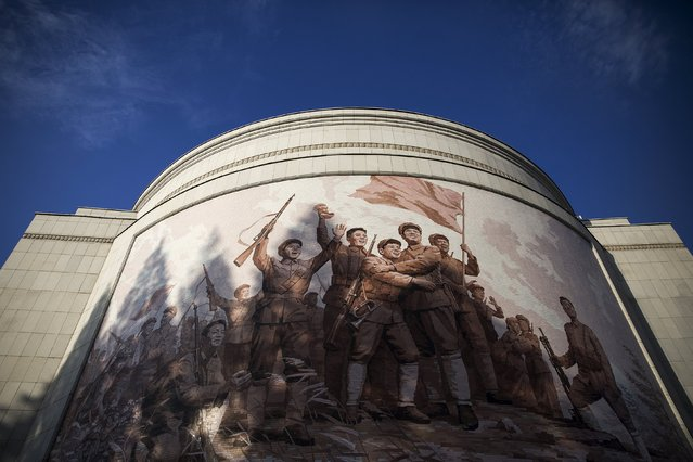 A mural decorates War Museum during a government organised tour for foreign reporters in Pyongyang, North Korea October 9, 2015. (Photo by Damir Sagolj/Reuters)
