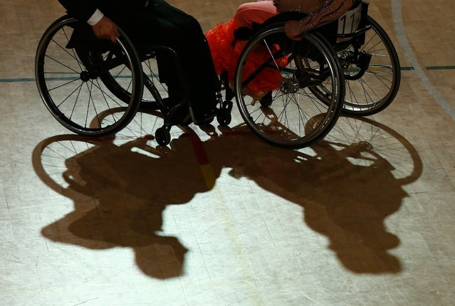Shadow cast by a pair dancing on wheelchairs during IPC Wheelchair Dance Sport European Championships in  Lomianki near Warsaw, November 9, 2014. (Photo by Kacper Pempel/Reuters)