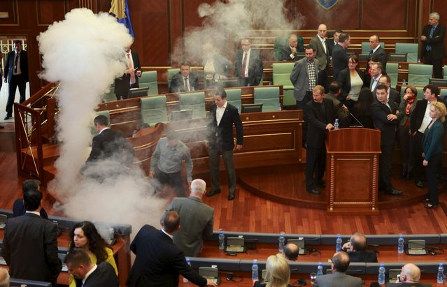 Teargas is seen released in Kosovo parliament October 15, 2015. An opposition lawmaker in Kosovo released teargas in parliament on Thursday, the second such incident in a week in protest at a European Union-brokered accord with former master Serbia. (Photo by Hazir Reka/Reuters)