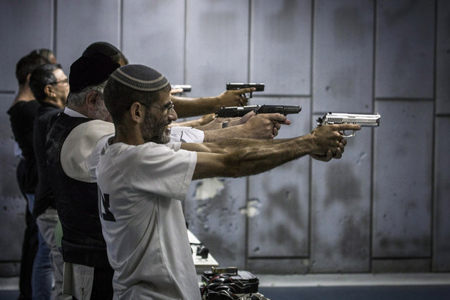 Israelis shoot in the gun shooting range on October 15, 2015 in Jerusalem, Israel. The Israeli Government issued police reinforcements across Israel following a wave of terror attacks across Jerusalem and the country. (Photo by Ilia Yefimovich/Getty Images)