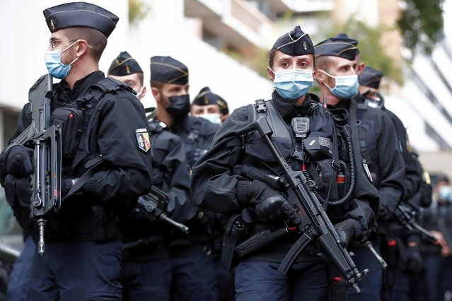 French police officers are deployed near the former Charlie Hebdo offices, in Rue Nicolas Appert in Paris, France, 25 September 2020, after four people have been wounded in knife attack. According to recent reports, one assailant has been arrested in the Bastille area. (Photo by Ian Langsdon/EPA/EFE)