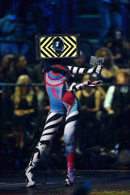 An MTV presenter in costume gets ready to give Justin Bieber the award for Best Male artist on stage during the MTV EMA's 2015 at the Mediolanum Forum on October 25, 2015 in Milan, Italy. (Photo by Brian Rasic/Getty Images for MTV)