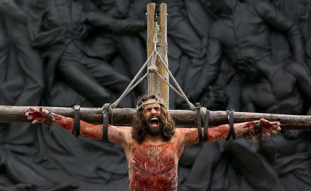 Actor James Burke-Dunsmore portrays the part of Jesus Christ during a performance in London's Trafalgar Square on Good Friday, on March 29, 2013. The play called 'The Passion of Jesus' was a free performance depicting the betrayal, capture, trial, crucifixion and resurrection of Jesus, performed by the Wintershall players. (Photo by Kirsty Wigglesworth/Associated Press)
