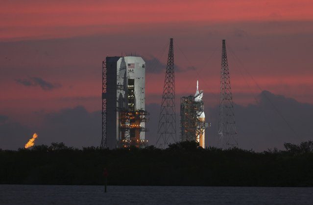 The Delta IV Heavy rocket carrying the Orion spacecraft sits on the launch pad awaiting liftoff in the sunrise at the Cape Canaveral Air Force Station in Cape Canaveral, Florida December 4, 2014. (Photo by Scott Audette/Reuters)