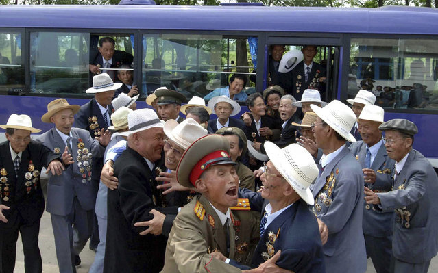 """North Korean war veterans arrive to attend celebrations of """"War Victory Day"""", which falls on July 27, of the 1950-53 Korean War in Pyongyang, on July 26, 2012. (Photo by Reuters/KCNA)"""