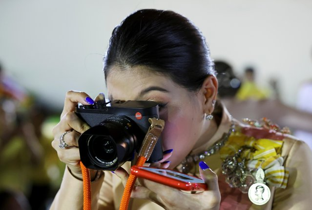 Thailand's Princess Sirivannavari Nariratana takes pictures after a religious ceremony to commemorate the death of King Chulalongkorn, known as King Rama V, at The Grand Palace in Bangkok, Thailand, October 23, 2020. (Photo by Athit Perawongmetha/Reuters)
