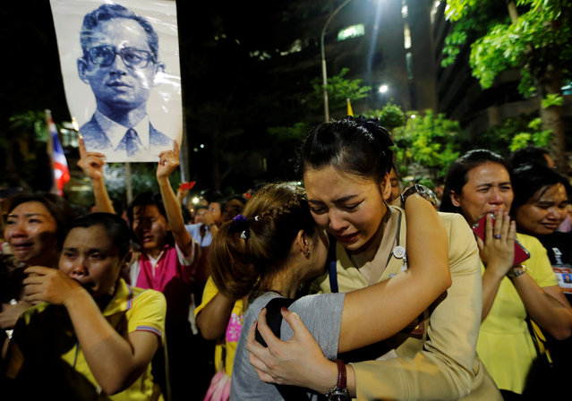 Well-wishers hug as they weep outside Thailand's King Bhumibol Adulyadej at the Siriraj hospital where he is residing in Bangkok, Thailand, October 13, 2016. (Photo by Jorge Silva/Reuters)