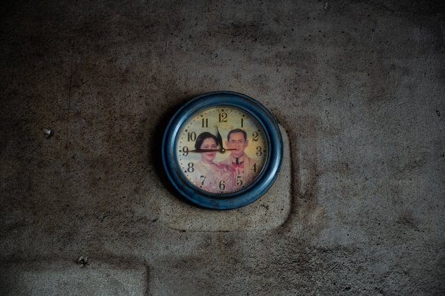 A faded image of Thailand's late King Bhumibol Adulyadej (Rama IX) and Queen Sirikit decorates a clock face in an old house on December 04, 2020 in Ranong, Thailand. Southern Thailand has long been seen as a stronghold of Royalist support. Reverence for the present and past kings is high, and publicly visible all across the southern provinces. Portraits of the royal family saturate public and private spaces in the region, a reminder that despite ongoing protests in the capital, support for existing institutions remains high in some parts of the country, and especially in the south. (Photo by Sirachai Arunrugstichai/Getty Images)