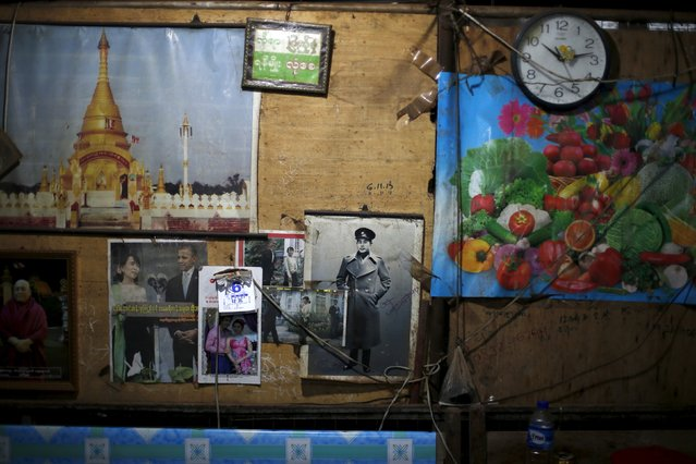 Picture of Myanmar opposition leader Aung San Suu Kyi, her late father General Aung San, and U.S. President Barack Obama are seen in a shop in Thiri Mingalar market in Yangon November 6, 2015. (Photo by Jorge Silva/Reuters)