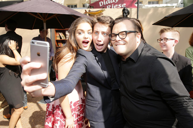 Odeya Rush, Ryan Lee and Jack Black take a selfie at Columbia Pictures and Sony Pictures Animation World Premiere of 'Goosebumps' at Regency Village Theatre on Sunday, October 4, 2015, in Westwood, CA. (Photo by Eric Charbonneau/Invision for Sony Pictures/AP Images)