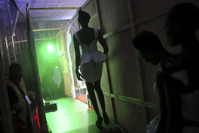 A model prepares to walk onto the catwalk during the Festi'Bazin runway show in Bamako, Mali, October 16, 2015. (Photo by Joe Penney/Reuters)