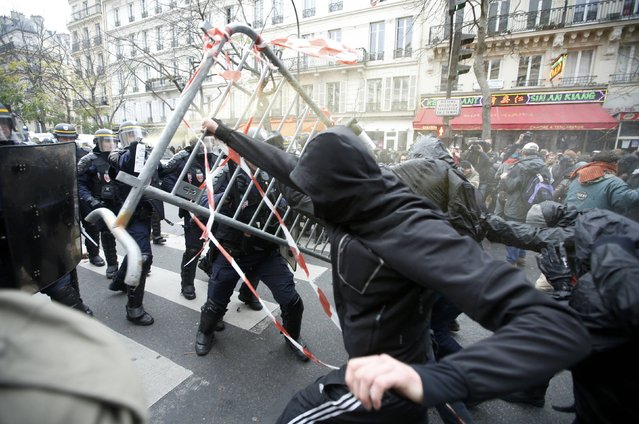 Demonstrators clash with CRS riot policemen near the Place de la Republique after the cancellation of a planned climate march following shootings in the French capital, ahead of the World Climate Change Conference 2015 (COP21), in Paris, France, November 29, 2015. (Photo by Eric Gaillard/Reuters)