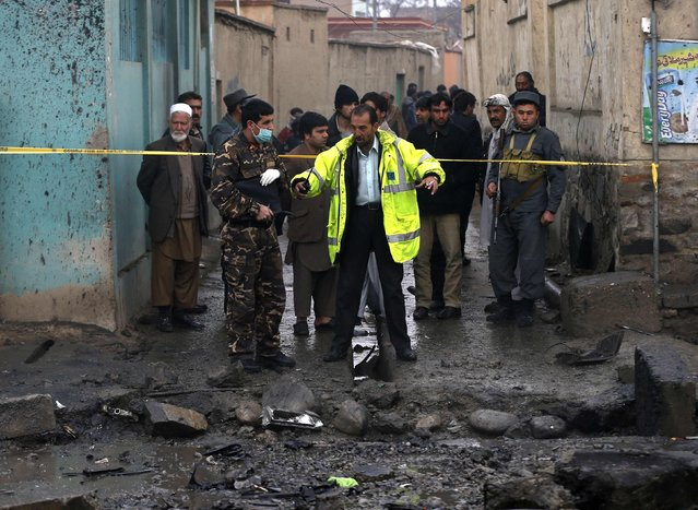 Afghan security personnel investigate the site of a blast in Kabul January 13, 2015. (Photo by Mohammad Ismail/Reuters)