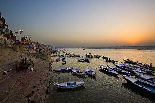 """Sunrise at Ganges River"". The Ganges is the most sacred river to Hindus and Varanasi is a city situated on the banks of the Ganges River. It is regarded as a holy city by Hindus and one of the oldest continuously inhabited cities in the world. (Photo and caption by Ng Hock How/National Geographic Traveler Photo Contest)"