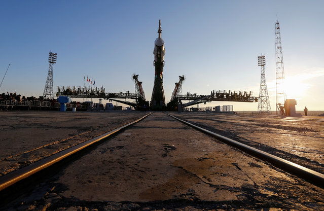 The Soyuz MS-03 spacecraft for the next International Space Station (ISS) crew of Peggy Whitson of the U.S., Oleg Novitskiy of Russia and Thomas Pesquet of France, is lifted on the launchpad ahead of its upcoming launch, at the Baikonur cosmodrome in Kazakhstan, November 14, 2016. (Photo by Shamil Zhumatov/Reuters)
