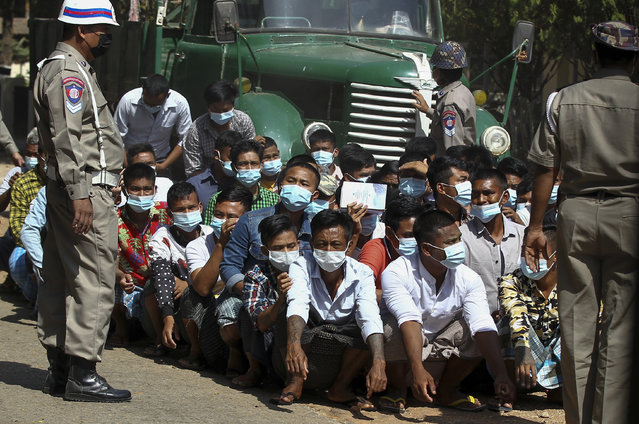 Prisoners, soon to be released marking the 74th anniversary of Myanmar's Union Day, wait for processing at the Insein prison in Yangon, Myanmar Friday, February 12, 2021. (Photo by AP Photo/Stringer)