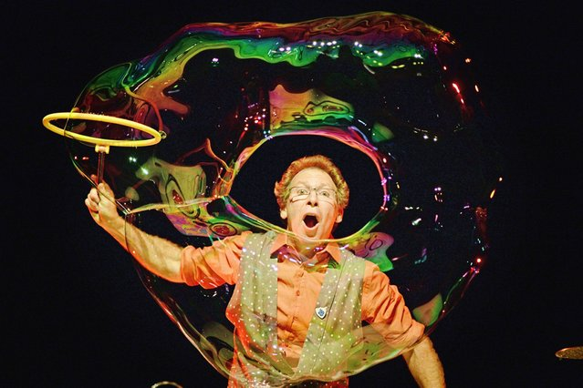 Louis Pearl from San Francisco, The Amazing Bubble Man, rehearses for his performance in the Assembly Rooms at the Edinburgh Fringe Festival, on July 31, 2013. (Photo by Jeff J. Mitchell/Getty Images)