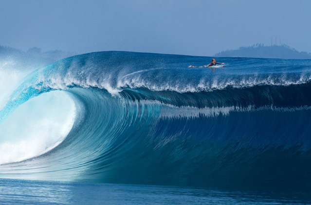 Photographer: Stuart Gibson. Athlete: Sean Woolnough. Location: Namotu Island, Fiji. (Photo by Stuart Gibson/Red Bull Illume via The Atlantic)