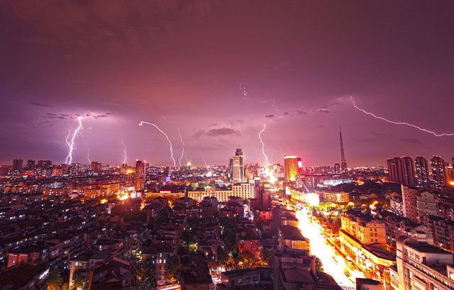 Lightning strikes over buildings during heavy rainfall in Kunshan, Jiangsu province, China, September 2014. (Photo by Reuters/China Stringer Network)
