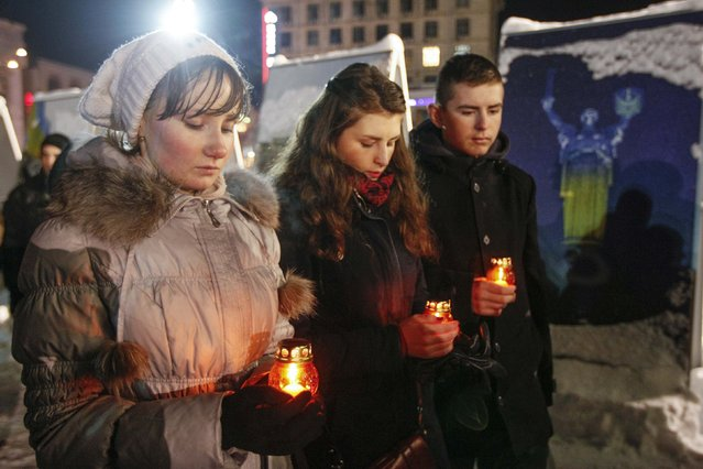 People take part in a vigil in memory of those who have lost their lives in east Ukraine, at Independence Square in Kiev, February 6, 2015. (Photo by Valentyn Ogirenko/Reuters)