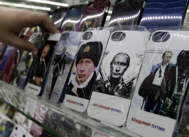 Mobile phones cases displaying images of Russian President Vladimir Putin, are pictured on display at an electronic store in Stavropol, southern Russia, February 12, 2015. (Photo by Eduard Korniyenko/Reuters)