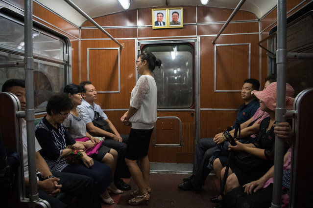 Pictures of Kim Il-sung and Kim Jong-il hang on the wall of a train carriage on the Pyongyang metro on August 21, 2018 in Pyongyang, North Korea. (Photo by Carl Court/Getty Images)