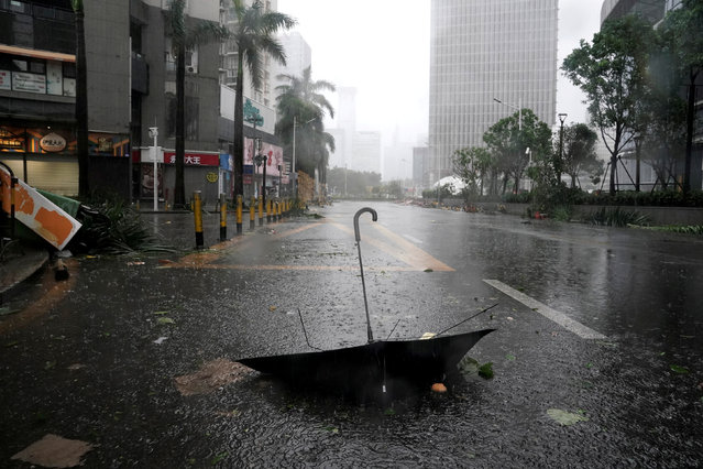An umbrella is seen on a road after a rainstorm as Typhoon Mangkhut makes landfall in Guangdong province, in Shenzhen, China on September 16, 2018. (Photo by Jason Lee/Reuters)