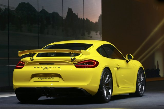 A Porsche Cayman GT4car is pictured during a Volkswagen Group event ahead of the 85th International Motor Show in Geneva, March 2, 2015.             REUTERS/Arnd Wiegmann (SWITZERLAND  - Tags: TRANSPORT BUSINESS)