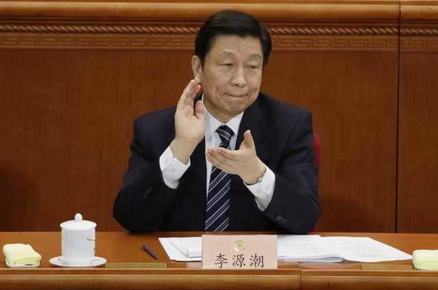 China's Vice President Li Yuanchao claps during the opening session of Chinese People's Political Consultative Conference (CPPCC) at the Great Hall of the People in Beijing March 3, 2015. REUTERS/Jason Lee MILITARY)