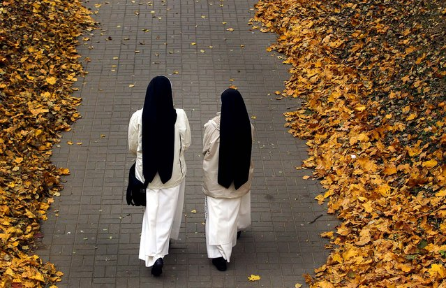 Catholic nuns walk in a park in the Belarusian capital of Minsk, October 14, 2013. (Photo by Sergei Grits/Associated Press)