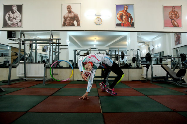 In this Monday, January 18, 2016 photo, Iranian rock climber, Farnaz Esmaeilzadeh, warms up in a gym ahead of rock climbing training session in the city of Zanjan, some 330 kilometers (207 miles) west of the capital Tehran, Iran. (Photo by Ebrahim Noroozi/AP Photo)