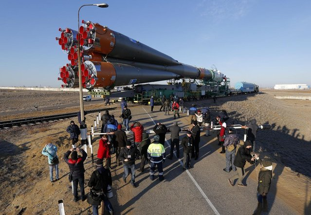 Russia's Soyuz-FG booster rocket with the space capsule Soyuz TMA-16M that will carry a new crew to the International Space Station (ISS) is transported from the hangar to the launch pad in Russian leased Baikonur cosmodrome, Kazakhstan, Wednesday, March 25, 2015. (Photo by Dmitry Lovetsky/AP Photo)
