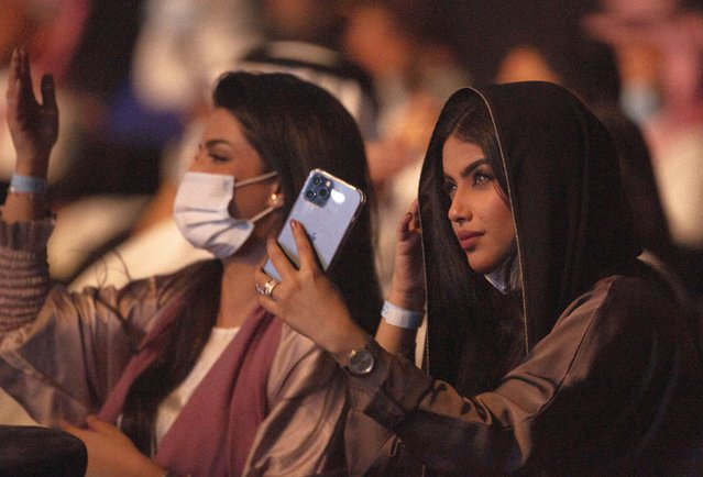 Coronavirus vaccinated audience members watch Saudi prominent singer Mohammed Abdu as he performs at the newly built Super Dome, in Jiddah, Saudi Arabia, late Thursday, July 8, 2021. The concert is organized by the Saudi General Entertainment Authority after the kingdom lifted coronavirus restrictions on events in May. (Photo by Amr Nabil/AP Photo)