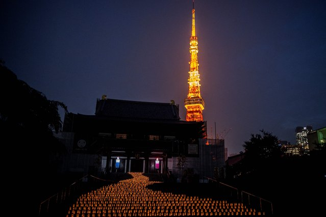 Around 2,000 candles are lit in front of Zojoji temple to mark the Tanabata or Japanese star festival in Tokyo on July 6, 2021. (Photo by Philip Fong/AFPPhoto)