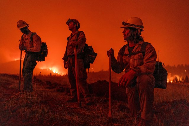 Forest Service firefighters monitor the Tamarack Fire just outside of the centre of Markleeville in California, USA on July 17, 2021. (Photo by Jungho Kim/ZUMA Press Wire/Rex Features/Shutterstock)