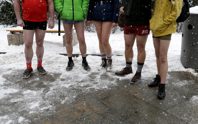 "Passengers not wearing pants prepare for  the ""No Pants Subway Ride"" in Prague, Czech Republic, January 8, 2017. The event is an annual flash mob and occurs in different cities around the world in January, according to its organisers. (Photo by David W. Cerny/Reuters)"