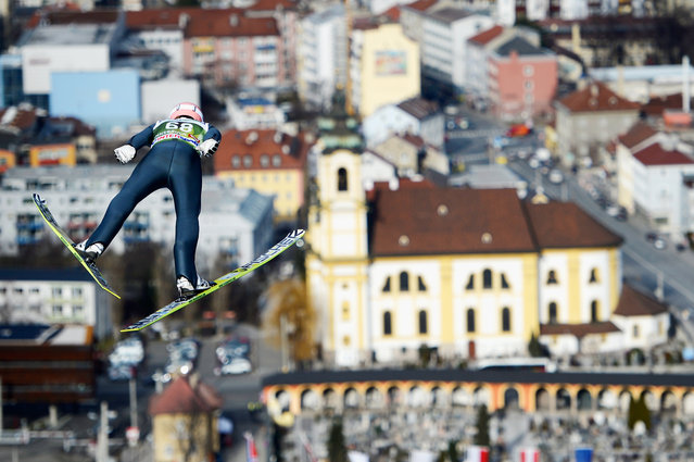 Severin Freund of Germany soars towards the Wiltener Basilica during his first training jump on day 1 of the Four Hills Tournament event at Bergisel on January 3, 2014 in Innsbruck, Austria. (Photo by Dennis Grombkowski/Getty Images/Bongarts)