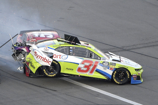 Tyler Reddick (31) is hit from behind by Cody Ware (52) during a NASCAR Daytona 500 auto race at Daytona International Speedway Sunday, February 17, 2019, in Daytona Beach, Fla. (Photo by Phelan M. Ebenhack/AP Photo)