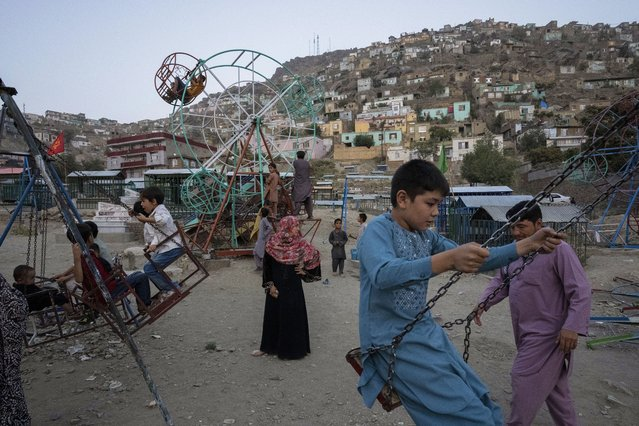 Children play at a park in Kabul, Afghanistan, Friday, September 10, 2021. (Photo by Bernat Armangue/AP Photo)