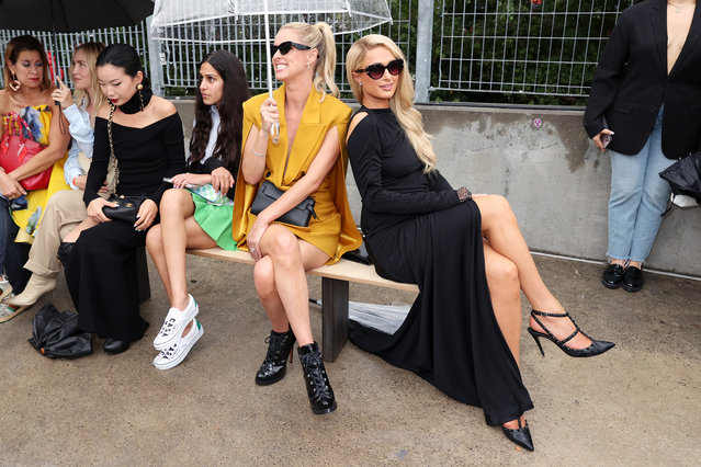 American businesswoman, socialite, model and fashion designer Nicky Hilton Rothschild (C) and American media personality Paris Hilton (R) attend the front row for Monse Resort 22 during NYFW: The Shows on September 09, 2021 in New York City. (Photo by Cindy Ord/Getty Images for Monse)