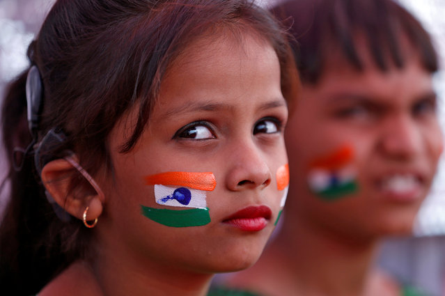 Children with the colours of the Indian national flag painted on their faces wait to perform during the Republic Day parade in Ahmedabad, India January 26, 2017. (Photo by Amit Dave/Reuters)