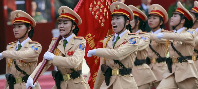 Vietnamese female traffic police officers march during a rehearsal for a military parade as part of the 40th anniversary of the fall of Saigon in southern Ho Chi Minh City (formerly Saigon City), Vietnam, on April 26, 2015. (Photo by Reuters/Kham)